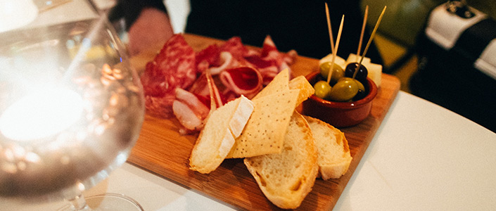 Enjoying tapas with cured ham jamón