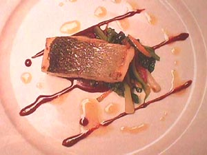 Baked sea bass with vegetables and Grenache sauce