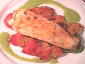 Sea bass with toasted almond scales and pea sauce