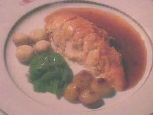 Chicken supreme with vegetables in tarragon sauce