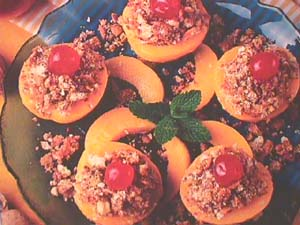 Peaches filled with honey, nuts and sponge fingers